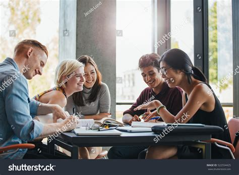 college work happy young university students studying books stock photo