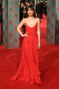 bafta awards 2016 carpet dakota johnson ruffled a line red dress bafta awards 2016