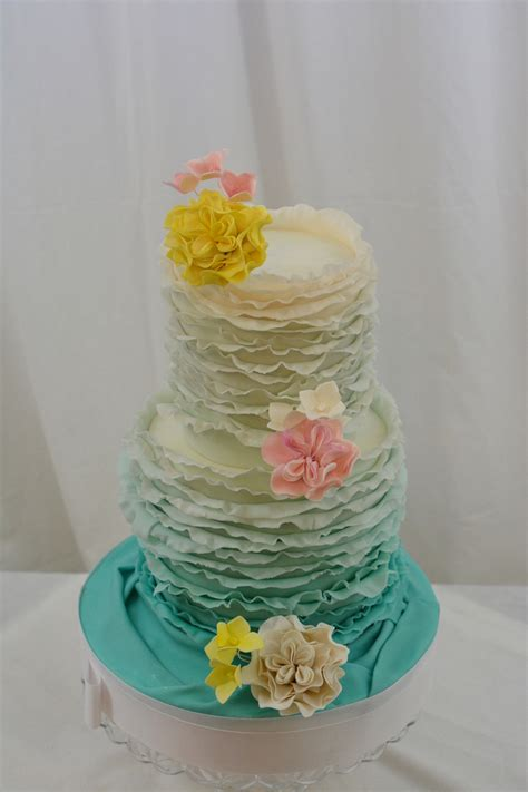 Pink And Yellow Baby Shower Cake by Teal Ruffled Baby Shower Cake With Pink Yellow And White