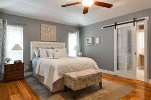Cottage master bedroom with barn door amp ceiling fan