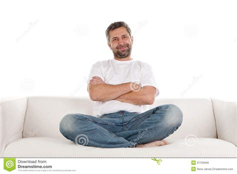 man on sofa casual man sitting on sofa royalty free stock images