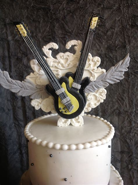 rock n roll theme wedding cake topper used idea from their invitations by leticiasconfections
