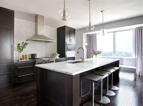 kitchen idea  dark floors dark cabinets white counter