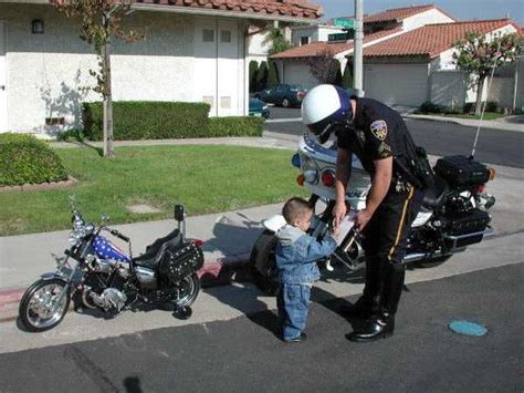 caption contest, kid pulled over on motorcycle   Buffet o