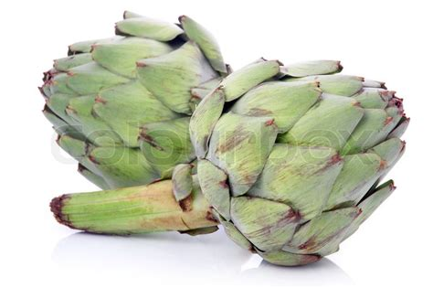 green vegetables p ripe green artichoke vegetables isolated on white