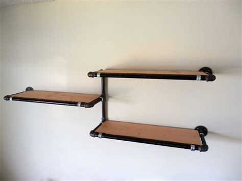 industrial pipe wall shelf with reclaimed by derekgoodbrand