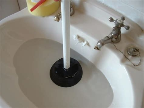 plunging bathtub drain sink unblocking plumbing