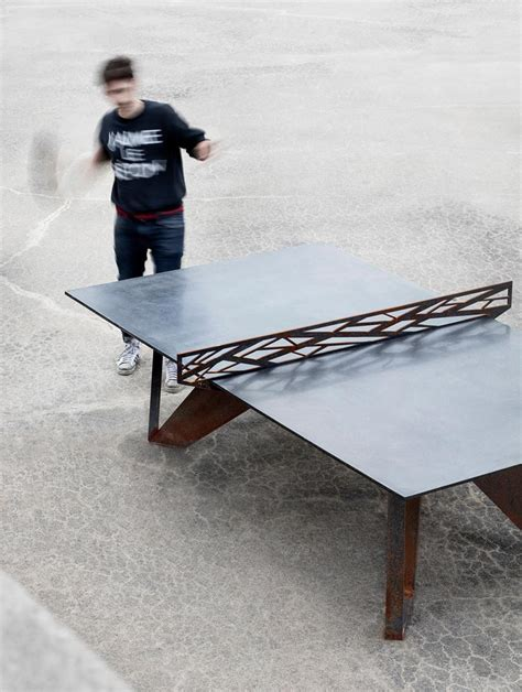 one of a ping pong table of corten steel and concrete