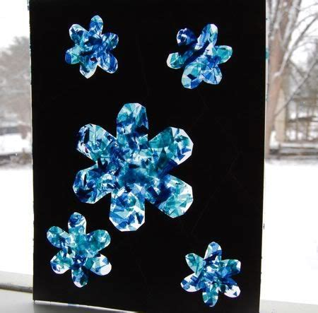 Paper Snowflakes For Preschoolers - contact paper snowflake sun catcher preschool