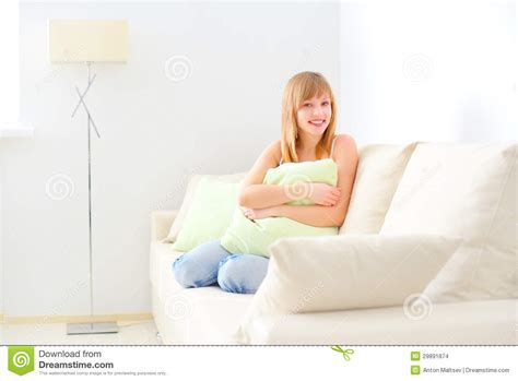 girl sitting on couch smiling girl sitting on sofa stock images image 29891874