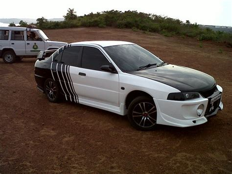 mitsubishi lancer black modified vishal s white with black stripes modified lancer