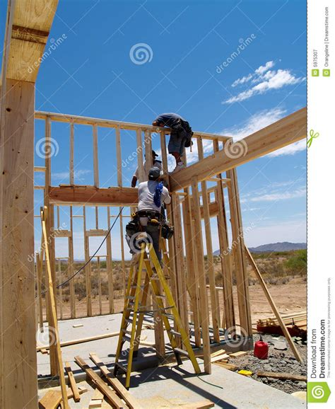 building an a frame house men building frame for house vertical stock image