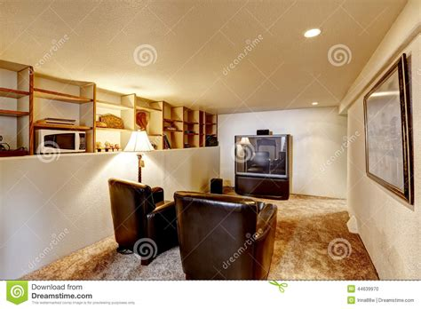 download basement tv room ideas erodriguezdesign com basement room with tv and two leather chairs stock photo
