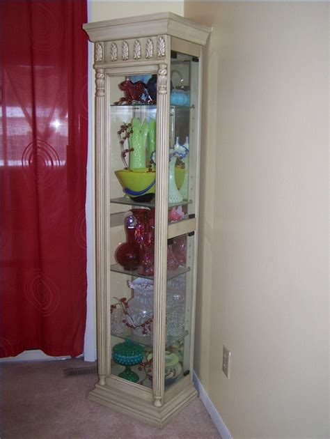 how to decorate a curio cabinet how to clean glass in a curio cabinet ehow