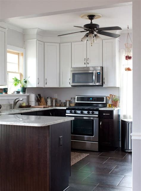 kitchen cabinets white top black bottom erin s family friendly atlanta kitchen kashmir white