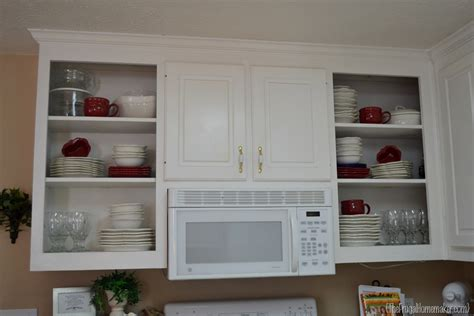 adding glass to cabinet doors kitchen cabinets design dilemma