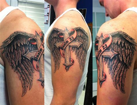 skin gallery tattooing body piercing wings and cross by skin yelp