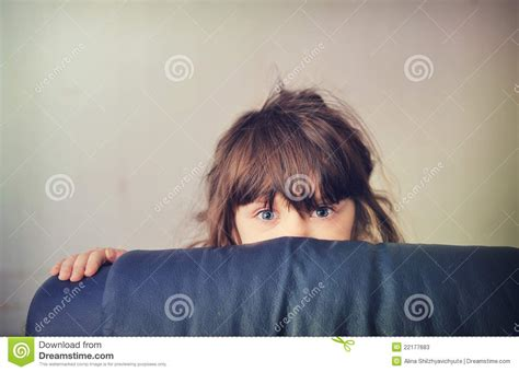 little girl behind the couch song little girl playing hide and seek behind the sofa stock
