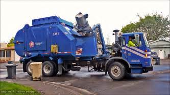 Garbage Truck by Garbage Trucks On Route In