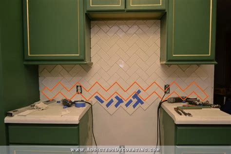 installing subway tile backsplash in kitchen how to install a herringbone subway tile backsplash