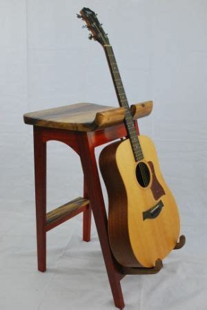 Guitar Stand Stool by Guitar Stand Wooden Chairs And Guitar On
