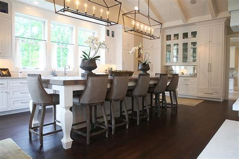 White Kitchen Island with Wood Countertop and Gray Stools