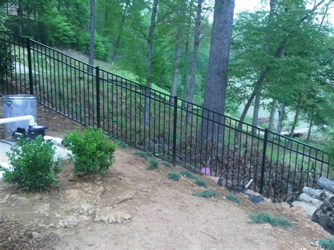 fencing a backyard adding a fence on a sloped back yard fence on steep hill new pa home ideas