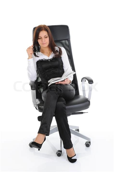 business woman drinking coffee  reading  book sitting   chair   bright office isolated