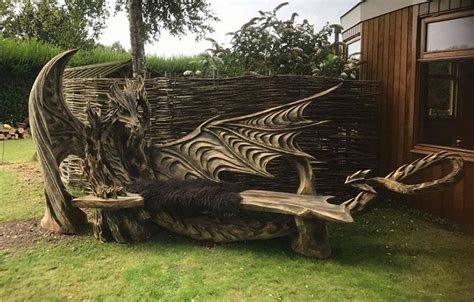 chainsaw carved bench guy chainsaw carves dragon bench out of single piece of wood geekologie