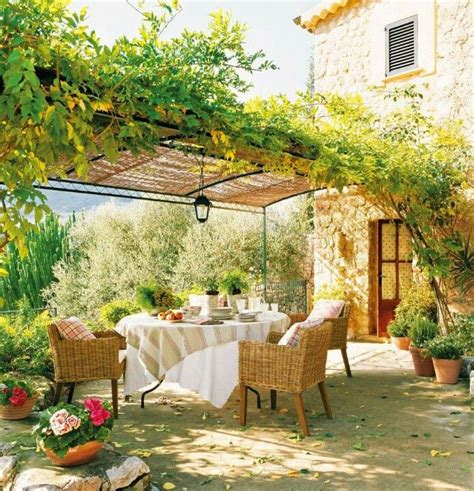 tuscan pergola dining under an italian pergola wicker and upholstery