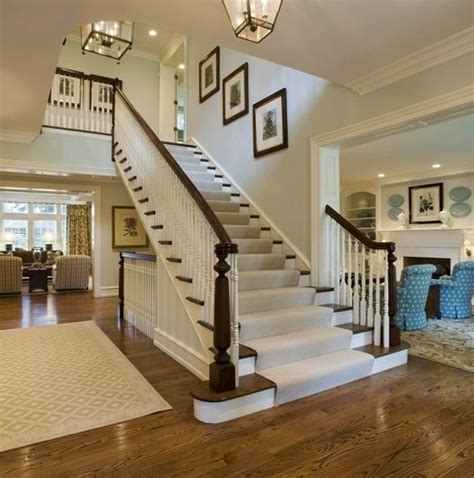 big white staircase beautiful wooden floors high love how open this staircase foyer is home sweet home