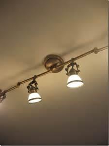 Pretty track lights antique brass finish with adjustable spotlights