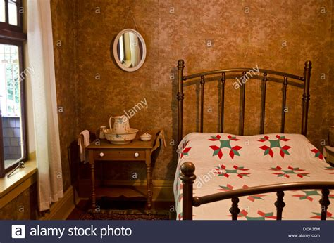 old fashioned bedroom vintage old fashioned bedroom setting with iron bed frame and wash stock photo royalty free