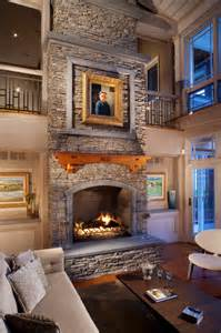 Ballard Design Stools large stacked stone fireplace with wood mantle and stone