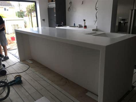 corian installation staron solid surface waterfall island kitchen