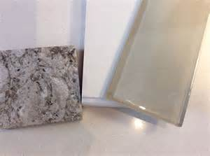 Glass Backsplash Ideas For Kitchens white shaker cabinet and taupe glass subway tile samples