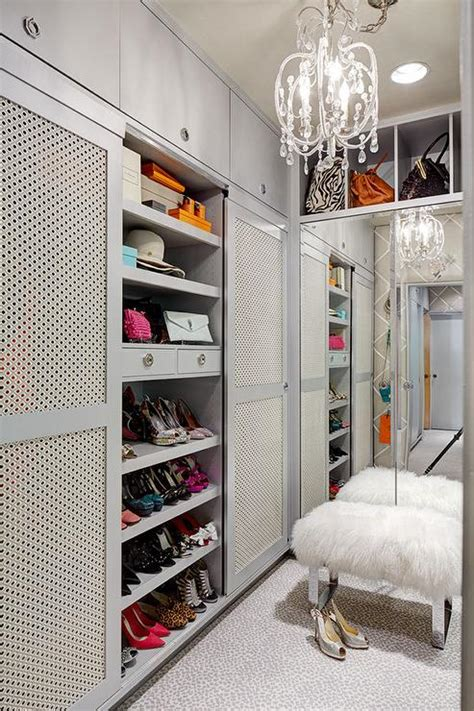 bench in closet walk in closet with black tufted bench on lucite legs