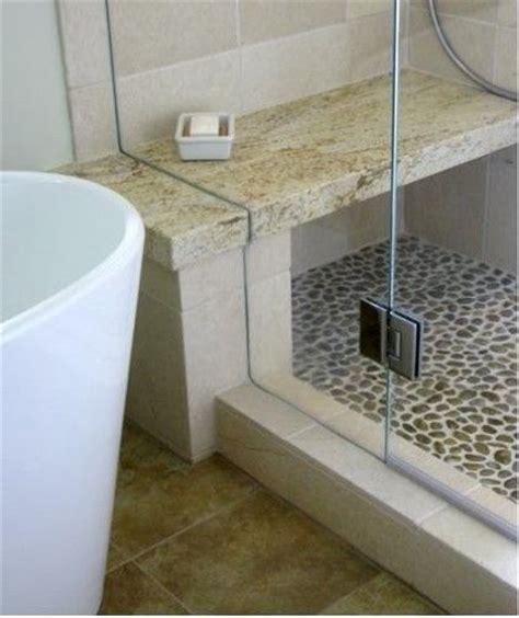 river rock shower bottom bench bathroom