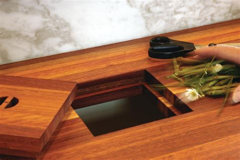 Kitchen Island With Trash Bin trash stash two clever solutions for kitchen garbage