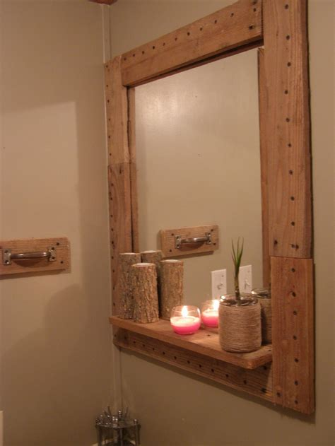 bathroom mirror hangers framed my bathroom mirror with pallets the towel hanger