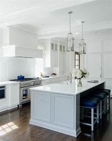 gray kitchen island with blue stools transitional kitchen