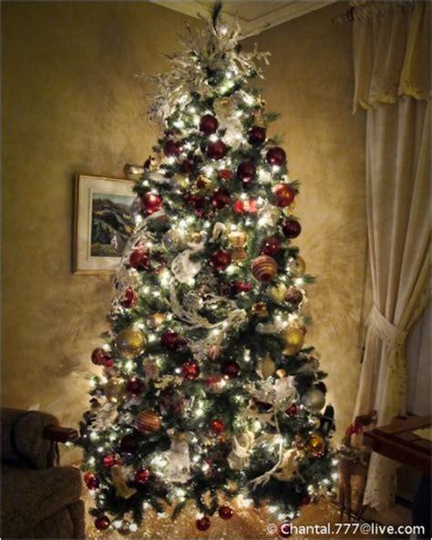 shiny ornaments christmas lights on a large xmas tree