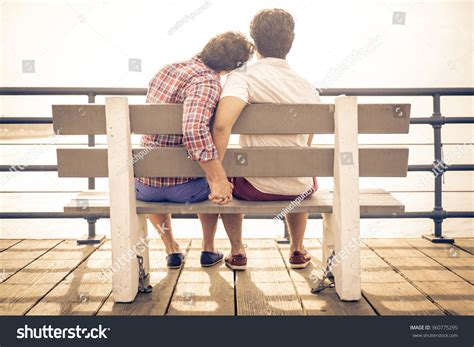 concept of bar bench relation happy couple love santa monica sitting stock photo