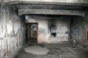 poster shows reconstructed gas chamber at auschwitz c