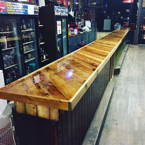 Wood Bar Top Ideas by Bar Top Made From Pallet Boards And Covered With Epoxy