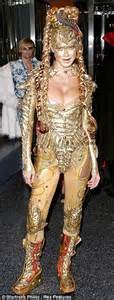 Heidi Klum As Witchs Brew by Heidi Klum Spreads In Colourfully Buggy Costume For