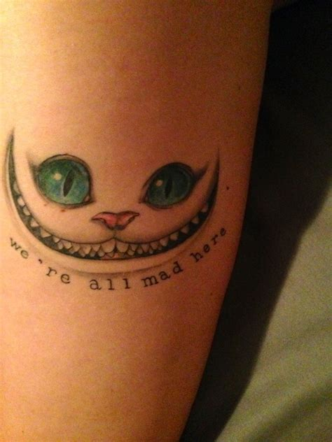chesire cat tattoo cheshire cat arm with quote tattoomagz