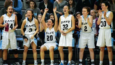 basketball bench cheers the girls varsity team cheers on the bench after senior