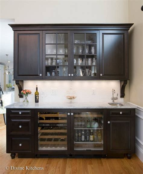 bar with raised panel cabinetry crown molding