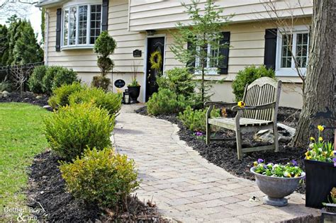split level landscaping curb appeal adding curb appeal with new shutters board and batten